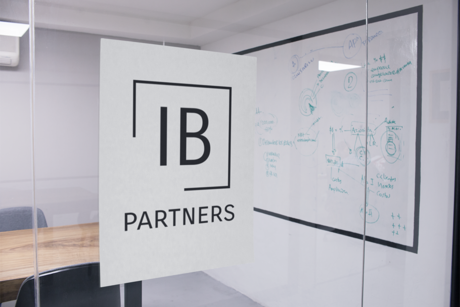 Looking into a classroom with IB Partners logo on the glass wall