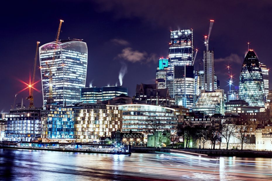 High rise insurance company office buildings in London at night
